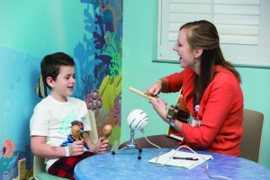 FRIDAY, DEC. 11, 2015 - Music therapist Ashley Warmbrodt (RIGHT) works with cancer patient Hayden Fife, 7, at Cardinal Glennon Children's Hospital as part of Maryville University's Kids Rock Cancer program. ©Photo by Jerry Naunheim Jr.